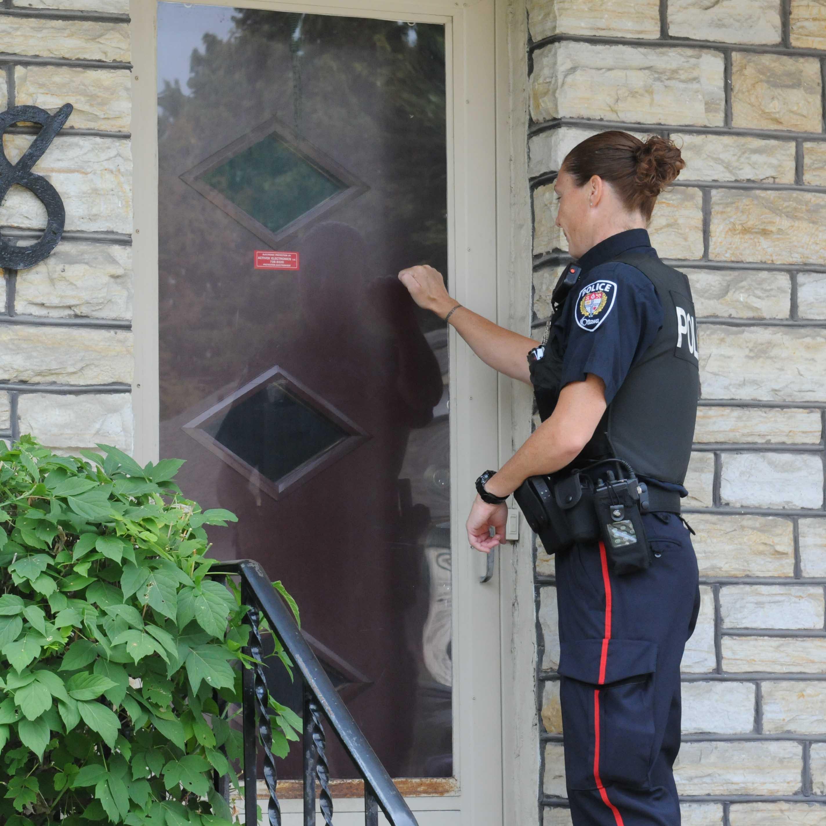 OPS officer at a door