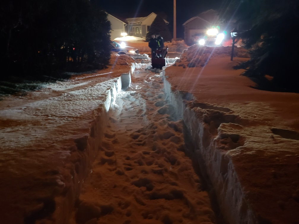 Officers shovel and snow blow driveway for elderly man