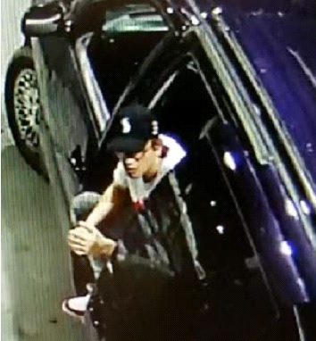 Male suspect No 2 with vehicle
